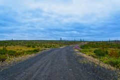 Road from crushed stone to cloudy weather Stock Images