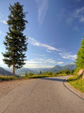Road Curve. In the Alps one summer day Royalty Free Stock Photography