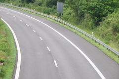 Road curve. Single tracked road curve with crash barrier Royalty Free Stock Photo