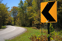 Road Curve Ahead Sign Stock Image
