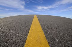 Road curve and blue sky Stock Photography