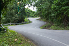 Road curve. The road curve on mountain in the forest Stock Photography
