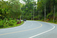 The road curve on mountain in the forest. Royalty Free Stock Photography