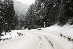 Road curve with snow. Road curve in winter with lot of snow and snow barriers Stock Photos