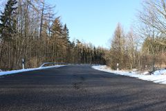 Road with curve in winter royalty free stock images