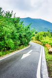 The road curved mountain Stock Images