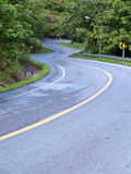 Road curves. Pass through the mountain and forest Royalty Free Stock Photos