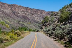 Road curves through the bottom of the Rio Grande Gorge near Taos, New Mexico stock images