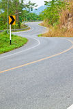 The road curves up the mountain Stock Images