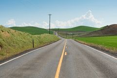 Road. Curving among rolling hills, Colfax, Washington royalty free stock photography