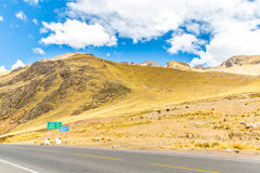 Road Cusco- Puno, Peru,South America. Sacred Valley of the Incas. Spectacular nature of mountains and blue sky Stock Image