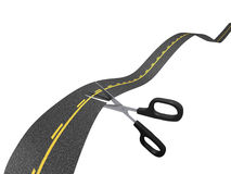 Road cut. A pair of scissors cutting a road to symbolize shortcut or a reduction of distance Royalty Free Stock Images