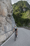 Road cycling - bicycle. Woman road cycling uphill - portrait Stock Image