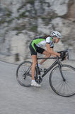 Road cycling - blurred road bike. Girl by downhill with road cycle - blurred motion Stock Images