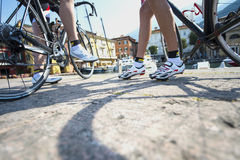 Road cycling detail wheel and shoes stock photography