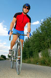 Road cyclist. Portrait of cyclists riding the road bike Royalty Free Stock Photography