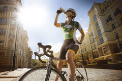 Road cyclist is drinking water stock photos