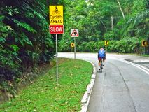 Cyclist - road signs royalty free stock photo