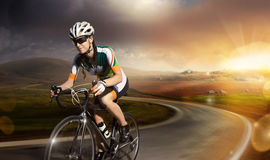 Road cyclist. Motion road cyclist. Sunset landscape. Crop royalty free stock images