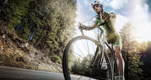 Road cyclist. Sport background. Cyclist ride on forest road Royalty Free Stock Photo