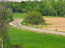 On the road. A cyclist walking on a beautiful Sunday in the countryside Royalty Free Stock Photos