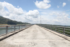 Road on dam ridge on summer in Thailand Royalty Free Stock Photos