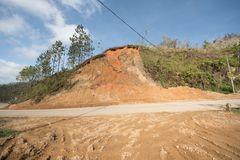Road damage from Hurricane Maria, Sep 2017. Cave ins and slides from flooding from Hurricane Maria stock photography