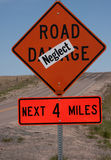 Road Damage Sign. With neglect pasted over to indicate displeasure with county maintenance Stock Image