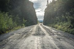 Giant pothole McCarthy Road from Chitina to McCarthy in Wrangell-St. Elias National Park. This road is dangerous, gravel road with potholes and railroad spikes royalty free stock images