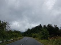 Road and dark sky stock images