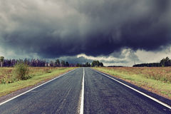 Road and dark thunder clouds Royalty Free Stock Photos