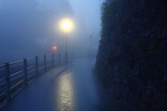 Road in dawn,Wengen Switzerland. Road in fog dawn,Wengen Switzerland August 08,2013 Royalty Free Stock Photos