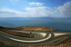Road beside the Dead Sea. Scenic view of road alongside the shoreline of the Dead Sea, Amman, Jordan Stock Photo
