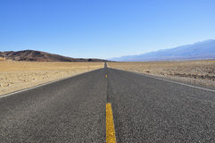 Road in Death Valley. National Park, going straight ahead Royalty Free Stock Photography