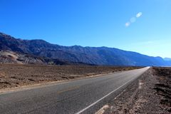 Road in the Death Valley National Park with colorful sky background, California Royalty Free Stock Photos
