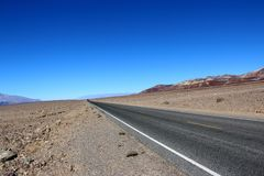 Road in the Death Valley National Park with colorful sky background, California Royalty Free Stock Image