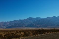 The road through Death Valley National Park, with the Panamint Mountains in the background. stock images