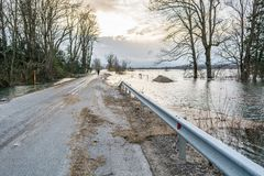 Road with debris left after the flood Royalty Free Stock Photos