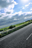 Road in denmark. Road in the north of denmark with green field and blu sky Royalty Free Stock Images