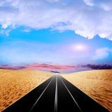 Road on the desert Stock Photo