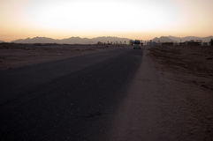 The road in the desert. The empty road in Egypt Royalty Free Stock Images