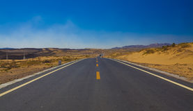 Road in desert Stock Image