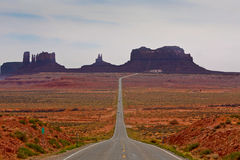 Road through desert. A straight desert road through the Monument Valley area in Arizona Stock Images