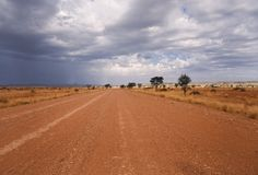 Road on a desert in Africa. Desert road in Africa, heavy sky Royalty Free Stock Photos