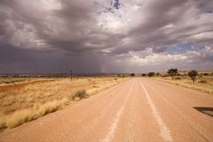 Road on a desert in Africa. Desert road in Africa, heavy sky Royalty Free Stock Photo