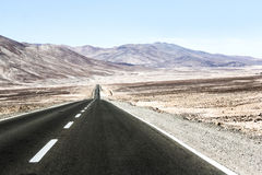 Road through the desert Stock Images