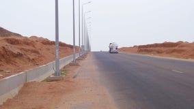 Road on the Desert. EGYPT, SOUTH SINAI, SHARM EL SHEIKH, NOVEMBER 29, 2016: Asphalt Road on the Desert. Car is driving on the desert road. Road traffic is moving stock video footage