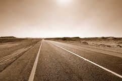 Road in the desert. Fragment of road in the desert. Sepia Royalty Free Stock Photography