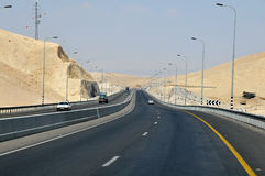 The road in the desert. Israel. The highway in Israel passing through the desert Royalty Free Stock Photo