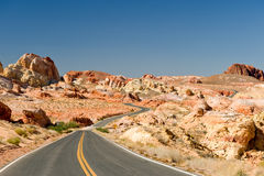 Road through desert landscape Stock Photos